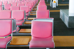 Row of pink leather chair at the airport Stock Photos