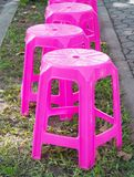 Row of pink plastic chairs. In the park Royalty Free Stock Photography