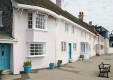 Row of pink seafront cottages Royalty Free Stock Images