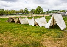 Row Of Pitched Canvas Tents In A Row. Row Of White Pitched Canvas Tents In A Row At Local Military Event royalty free stock image