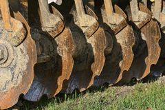 Row of Plain Cone Notched Disc Blades Royalty Free Stock Images