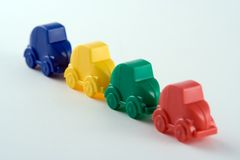 Row of Plastic Cars. Traffic jam or production line of plastic cars Stock Photo