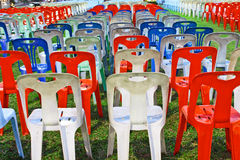 Row of plastic chair on yard Royalty Free Stock Photos