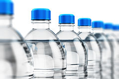 Row of plastic drink water bottles Royalty Free Stock Photos
