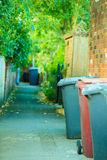 Row of plastic wheely bins outside houses in England Royalty Free Stock Images