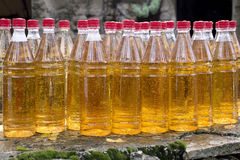 Row of plastic white wine bottles with red corks Royalty Free Stock Images