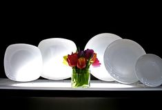 Row of plates stock images