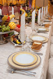 Row of plates in a banquet Stock Image