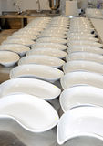 Row of plates in a large kitchen Royalty Free Stock Photo