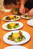 Row of plates with salad served on table Royalty Free Stock Photography