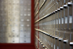 Row of PO Boxes. A seemingly never ending row of PO boxes at an unidentifiable Canada Post facility Royalty Free Stock Photo