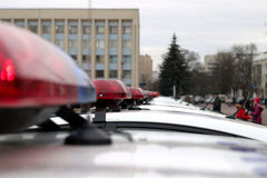 Row of police cars, with blue and red flashing sirens, Ukraine, selective focus Royalty Free Stock Photography