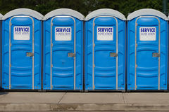 Row of Portable Toilets. Row of Portable Blue Toilets stock photo