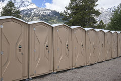 Row of  portable toilets. A row of brand new portable toilets in an outdoor location Royalty Free Stock Photos