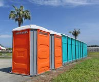 Portable Toilet Facilities. A row of portable toilets set up at a public event royalty free stock photography