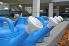 Row of portable watering cans or watering pot made from polymer Stock Photo