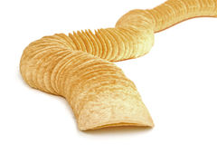 Row of potato chips isolated on white Royalty Free Stock Images