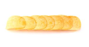 Row of potato chips on a white background Royalty Free Stock Photography