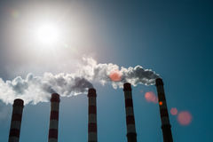 A row of power plant chimney Stock Image