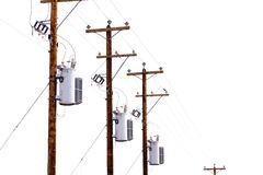 Row of power pole transformers isolated on white Royalty Free Stock Photos
