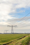 Row of power pylons in a rural Dutch landscape Stock Photo