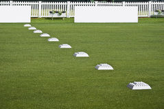 Row of Practice Balls, Blank Signage Boards. Row of golfers practice balls, set up before the start of play Stock Photography