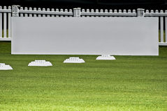 Row of Practice Balls, Blank Signage Boards. Row of golfers' practice balls, set up before the start of play Stock Photography