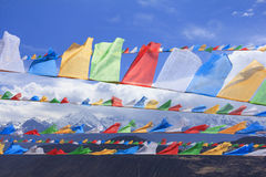 Row of prayer flags and Meili snow mountain, Deqing, Yunnan, China Stock Images