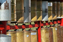 Row of Prayer wheels Stock Image
