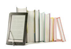 Row of printed books with electronic book reader Royalty Free Stock Photography