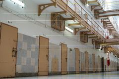 Row of prison cell doors. Doors of prison cells in the corridor in a row, jail, bar, penitentiary, justice, criminal, old, building, crime, interior, security stock images