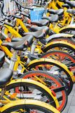 Row of public rental bikes, China. Bicycle-sharing system stock photo