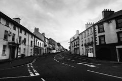 Row of pubs and bars in the city of Ballycastle, Causeway coast in Northern Ireland, UK. Black and white. Ballycastle, Northern Ireland. Row of pubs and bars in stock images