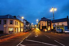 Row of pubs and bars in the city of Ballycastle, Causeway coast in Northern Ireland, UK in the evening. Ballycastle, Northern Ireland. Row of pubs and bars in stock photography