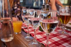Row of pure drinking water glasses at summer terrace cafe. Stock Image