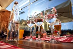 Row of pure drinking water glasses at summer terrace cafe. Stock Images