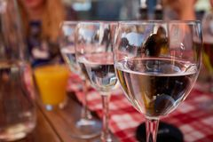 Row of pure drinking water glasses at summer terrace cafe. Royalty Free Stock Photography