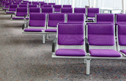 Row of purple chair at airport Stock Photography