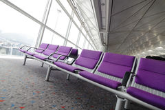 Row of purple chair at airport Royalty Free Stock Images