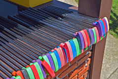 Row of putters at mini-golf course at the seashore stock photos
