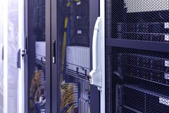 Row of racks in big data center inside close up. Datacentre interface and equipment royalty free stock images