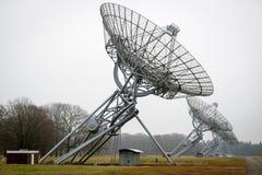 A row of radio telescope dishes Stock Photos
