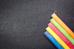 Row of rainbow chalk on blackboard Stock Photo
