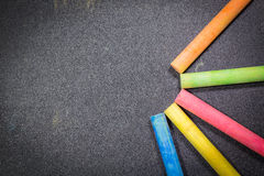 Row of rainbow chalk on blackboard Royalty Free Stock Images