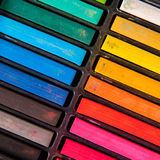 Row of rainbow chalk Stock Images