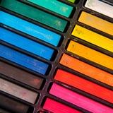 Row of rainbow chalk Stock Images