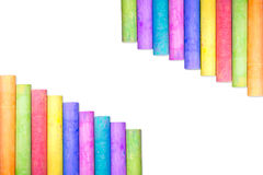 Row of rainbow chalk isolate on white background. Row of rainbow colored chalk isolate on white background Stock Images