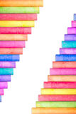 Row of rainbow chalk isolate on white background. Row of rainbow colored chalk isolate on white background Royalty Free Stock Images