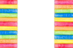 Row of rainbow chalk isolate on white background. Row of rainbow colored chalk isolate on white background Royalty Free Stock Photography