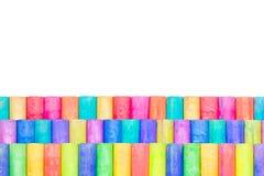 Row of rainbow chalk isolate on white background. Row of rainbow colored chalk isolate on white background Royalty Free Stock Image